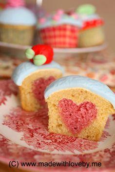 How to bake hearts into a cupcake.  TOO CUTE!