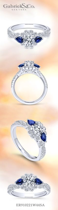 Gabriel NY - Preferred Fine Jewelry and Bridal Brand. 14k White Gold Round Halo engagement ring.A precious floral inspired engagement ring with diamond and sapphire adorned halo, accented with pave diamonds and milgrain detailing Find your nearest retailer-> https://www.gabrielny.com/storelocator