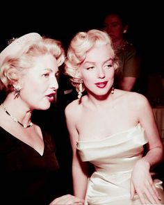 Marilyn with Sheilah Graham at a birthday party for Walter Winchell at Ciro's Nightclub, May 13th 1953.