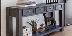 The Gavelston Sofa Table compliments a modern living room. Crafted from hardwood solids with wood seamed veneers, it's finished in a dry vintage weathered black. Shop online now. #LivingSpaces