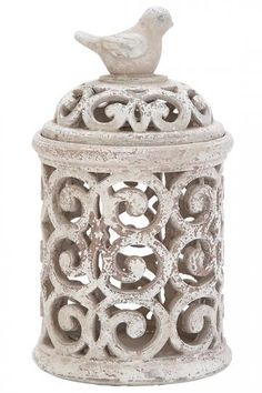 Put a bird on it. Loving this pierced jar for decoration on a console table or bookcase. HomeDecorators.com