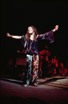 Janis Joplin photographed by Henry Diltz at Woodstock, August 1969.