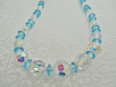 Vintage Crystal Bead Necklace Blue & Clear by KKCollectibleCollage, $16.50 https://www.etsy.com/listing/167913417/vintage-crystal-bead-necklace-blue-clear