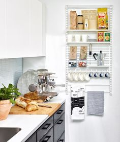 How you can use Elfa's products in the kitchen, for a smaller wall storage with shelves, boxes and hooks.