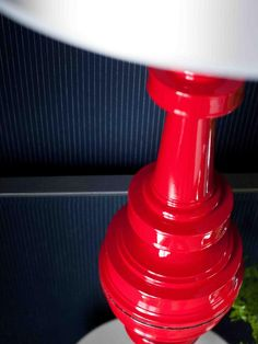A pair of traditional brass lamps is refinished in high-gloss red nautical paint. #red