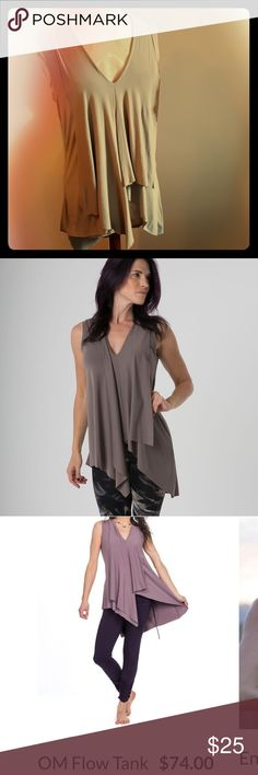 Flowy asymmetrical tank The Om Collection Super soft asymmetrical flowy tank. Perfect with leggings. Long enough to cover the butt. In amazing condition! Size small but fits Medium or even Large (very stretchy and flowy) the om collection Tops Tank Tops