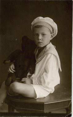 Vintage photo of little boy with his Teddy bear.