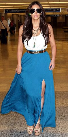 For a Miami lunch date, Kim shows some leg in a jewel-toned skirt, simple white tank and layers of necklaces.