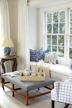 Blue and white living room with window seat - Interior Design by Carrier and Company My Living Room, Home And Living, Living Spaces, Interior Exterior, Home Interior Design, Cozy Nook, Cozy Corner, White Rooms, White Houses