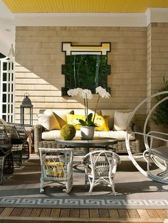 This sunny porch mixes different seats to create a comfortable atmosphere. More porch ideas: http://www.bhg.com/home-improvement/porch/porch/outdoor-porch-design-and-decorating/?socsrc=bhgpin061513yellow