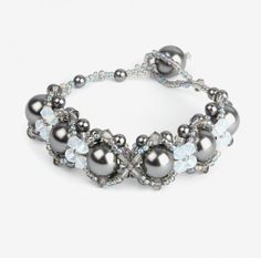 Learn how to make a stunning and intricate bracelet with a beaded clasp. This design is perfect for practicing your beading skills and the finished bracelet is ideal for giving as a thoughtful gift. <3