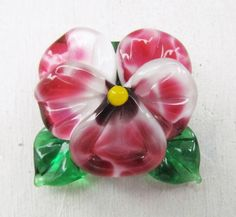 Lampwork pansy made of white, pink and green glass Perfectly fits for a pendant  Size of bead: approximately 30 mm  The sizes are approximate as each bead is handmade and may vary slightly (2-3mm).   Diameter of hole: 2mm The hole is running in vertical direction Flat base  *** All beads are made by me in my home studio in Saint-Petersburg and are kiln annealed for lasting durability.  Find more of my lampwork glass beads here in my Etsy shop: https://www.etsy.com/ru/shop&...