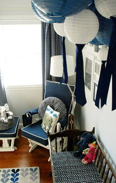 Love the idea of using navy blue as a base and bringing in lots of bright colors When the baby gets here you can add touches of pink or green depending on what it is
