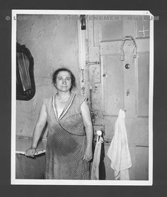 "A woman stands in her Lower East Side apartment kitchen. Photograph was a part of the ""One Third of a Nation: The WPA Photographs of Arnold Eagle"" November 1988 exhibit at the Lower East Side Tenement Museum, 97 Orchard Street. (New York, 1935)"