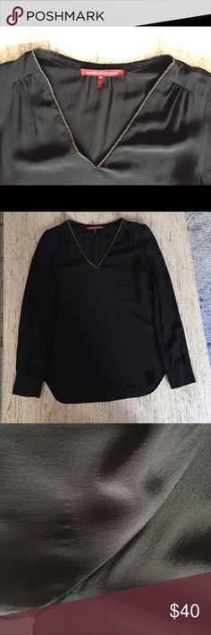 Comptoir des Cotonniers silk blouse size 34 Worn two or three times. Black 100% silk long sleeved v-neck blouse with silver chain detail at the neck line. Pull over style. Slight gathering details near the collarbone and at the back of the neck. 2 buttons on each sleeve. There's a small pucker/internal pull on the right sleeve near the shoulder (photo 3). French size 34 would best fit an XS/US 0. So chic, but just too small for me to wear anymore! Comptoir des Cotonniers Tops Blouses