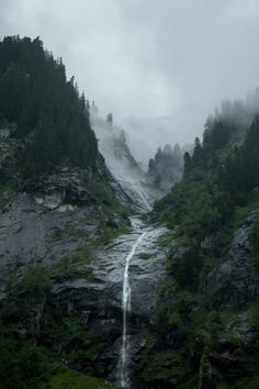 waterfall in the foggy mountains