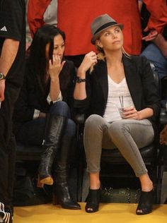 Charlize Theron watches the Los Angeles Lakers at the Staples Center in Los Angeles, CA.