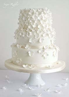 White Wedding Cakes - Yes! These lovely white wedding cakes have just made my day. It's such a great feeling to come across beauty so unexpectedly, especially when it involves perfectly crafted cake masterpieces made with brilliant floral . White Wedding Cakes, Elegant Wedding Cakes, Beautiful Wedding Cakes, Wedding Cake Designs, Wedding Cake Toppers, Beautiful Cakes, Wedding White, Floral Wedding, Wedding Simple