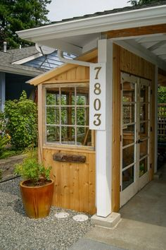 Lean To Greenhouse /shed to carport.  Edmonds In Bloom.  Photo by C. Stavig, Greencliff Landscape Co.