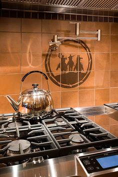 Cowboy Tile Back Splash For The Stove In The Kitchen Interior Design