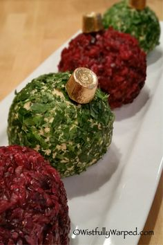 What holiday celebration is complete without a cheese ball? These Christmas ornament cheese balls are super simple to make a pack a pretty presentation. Christmas Cheese, Christmas Party Food, Christmas Brunch, Christmas Appetizers, Christmas Cooking, Appetizers For Party, Christmas Treats, Holiday Treats, Appetizer Recipes