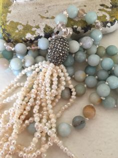 A personal favorite from my Etsy shop https://www.etsy.com/listing/290827999/bohemain-glam-pearl-tassel-jewelry-hand
