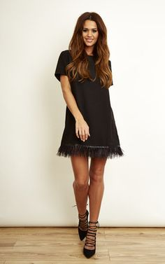 We're loving this black dress trimmed with black feathers.