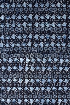 Africa | Adire electro cotton wrapper from the Yoruba people of western Nigeria | Stencil start resist and indigo dyed cotton | ca. 1950s/60s || Partial view