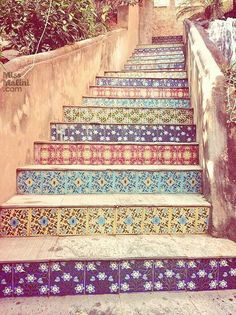 If I ever have concrete steps outside my house....Love the look of these patterned tiles on the steps!