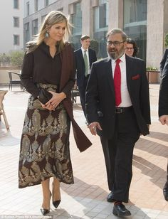 The following day (Tuesday) Maxima was pictured in her typical glamorous attire as she met with Governor of the State Bank (not pictured)