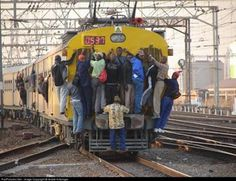 Only in South Africa - too many commuters, not enough coaches!
