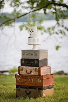 what better way to display a wedding cake than with vintage suitcases?