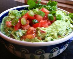 Homemade guacamole  @Tim Harbour Shute Cook BlissJust Eat Real Food Homemade guacamole via Primal Bliss  In food processor until smooth: 2 ripe avocados, handful of fresh cilantro, juice of 1 lime, sea salt, 1 clove fresh garlic, white pepper.  Fold in 1 diced tomato and 2-3 chopped scallions. Save some to sprinkle on top!  optional add in: jalapeño, bacon