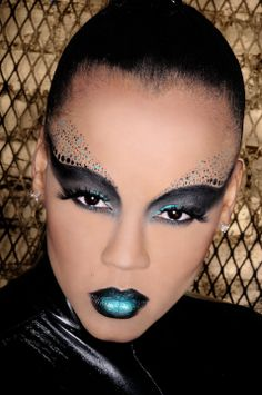 Alien makeup black gray shadow blue teal lips dots