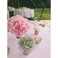 Soft Blush Hydrangea, Babies Breath and White Carnation Wedding Reception Table. All Set in Gold and Blush Pink  Mercury Glass Vases and Candle Holders