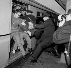 Historical images of New York City Subway, New York City policemen tangled with demonstrators at a subway station on the opening day of the New York World's Fair, April 22, 1964. Youths attempted to stall the train, which was headed from the city to the fairgrounds, as a form of protest on behalf of civil rights for blacks. (AP Photo/Charles Gorry)