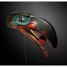 A Kwakiutl raven mask, British Columbia, Northwest Coast. This is amazing - it looks like the sun would roll forwards as the mouth opens.
