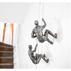Climbing Man Wall Sculpture of silver and bronze, Copper rock climber man, these are cool gifts for climbers and woman, his and hers for the very best unusual gifts this Christmas at Smithers store Uk