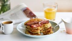 Thick, fluffy pancakes served the American way with glazed bacon and maple syrup.