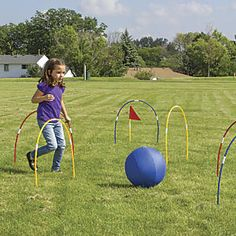 "Giant Kick Croquet Set: Combine the speed of soccer with the thrill of kids croquet, and you get…giant kick croquet! Instead of using mallets, kids kick two 16"" inflatable balls through seven oversized wickets. To ramp up the activity, stake the wickets further apart! A unique lawn game that encourages kids to get active. Two flags and storage bag included..."