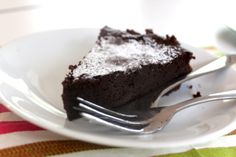 Amazing flourless chocolate cake.  Made it 1/3/14.  Intensely rich chocolate taste but actually light in the mouth.  I cut the sugar to 1/2 C. and used semi-sweet chocolate chips.  Perfect for us.