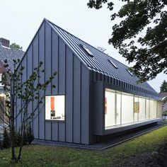 Suburban house in the Netherlands converted into a dentist's surgery with a new zinc-clad wing by Shift.