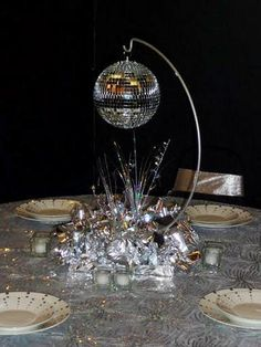 party Pavi - a different idea - how about this stand with a flower ball (instead of disco ball) hanging, greens or branches around hanger and puffs in pink and green at base Event Decor Photo Gallery Disco Theme Parties, Disco Party Decorations, Disco Birthday Party, 70th Birthday Parties, 50th Party, Party Centerpieces, Anniversary Parties, 1970s Party, Dance Themes