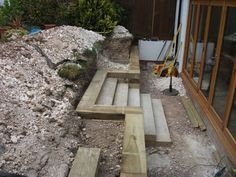 Steps, walls & Patio with new railway sleepers Garden Retaining Wall, Sloped Garden, Concrete Garden, Sleeper Retaining Wall, Sloped Backyard, Steep Gardens, Back Gardens, Backyard Patio Designs, Front Yard Landscaping
