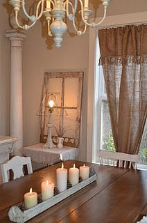 I love the burlap curtains ... such a pretty room
