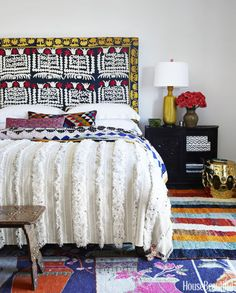 """""""All the color and pattern really make the guest room pop,"""" says Burnham, who added a vintage suzani headboard and Moroccan rugs."""