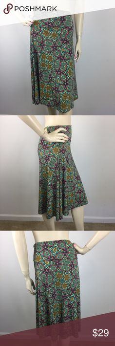 """Lularoe Azure Skirt Medium CONDITION: New without tags. MATERIAL: 96% Polyester 4% Spandex  (Please note that the measurements are approximate) ALL MEASUREMENTS ARE TAKEN WITH GARMENT LYING FLAT: WAIST: 14"""" HIPS: 20"""" LENGHT: 27"""" LuLaRoe Skirts A-Line or Full"""