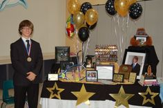 graduation table and decorations display school awards and photos