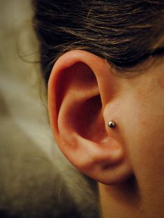 I have this piercing..... and LOVE it. It's my favorite by far.