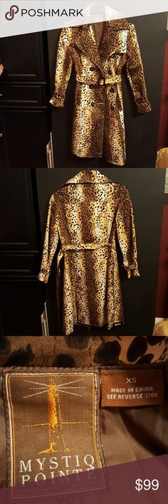 Women's extra small knee length trench coat This is a one-of-a-kind double-breasted knee-length leopard print trench coat. It's absolutely stunning and it always gets lots of compliments! It has front pockets, adjustable waist belt, an adjustable wristbands. NEW CONDITION..... only worn a few times.  If you want to be noticed when you walk in the door for the party.... then this is the coat for you! Jackets & Coats Trench Coats